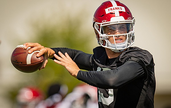 Arkansas quarterback Feleipe Franks throws a pass during practice Monday, Aug. 17, 2020, in Fayetteville.