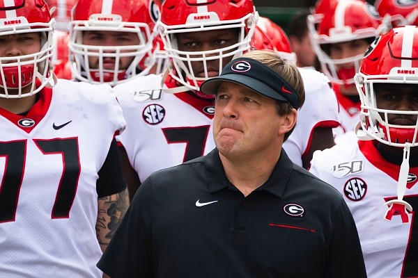 Georgia coach Kirby Smart waits with players to enter the field to take on Georgia Tech Yellow before an NCAA college football game Saturday, Nov. 30, 2019 in Atlanta. (AP Photo/John Amis)