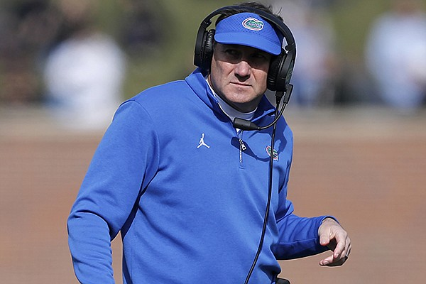 In this Nov. 16, 2019, file photo, Florida head coach Dan Mullen watches from the sideline during the first half of an NCAA college football game against Missouri in Columbia, Mo. Mullen had several players miss the team's opening training camp practice Monday, Aug. 17, 2020. (AP Photo/Jeff Roberson, File)