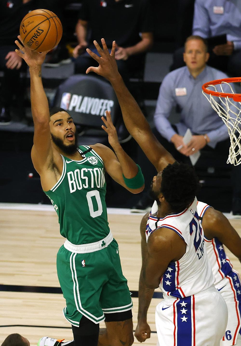 Jayson Tatum (left) of the Boston Celtics shoots over Joel Embiid of the Philadelphia 76ers during the Celtics' victory in the NBA Eastern Conference playoffs Wednesday night at Lake Buena Vista, Fla. Tatum made 8 of 12 three-pointers and led the Celtics with 33 points. (AP/Kevin C. Cox)