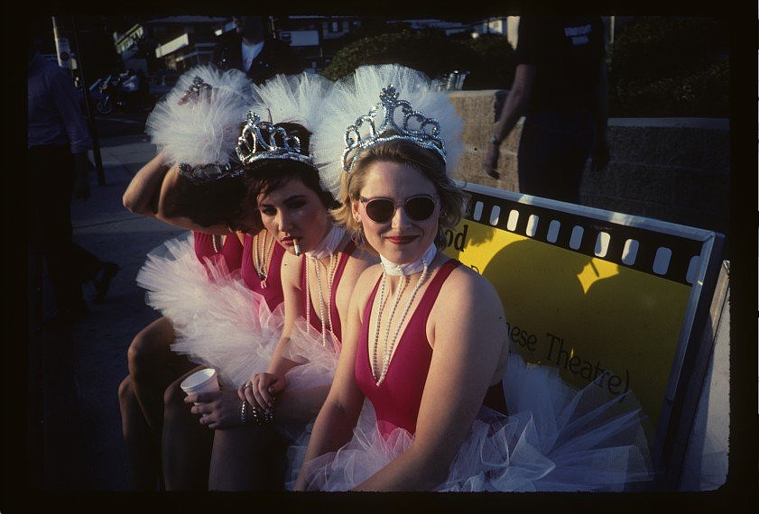 """This  Polaroid  photograph  was  taken  by  Go-Gos  manager  Ginger  Canzoneri during a break from a photo shoot for the cover of the band's second album, """"Vacation."""" Sitting, from left, are an uniden-tifiable Go Go, Belinda Carlisle, Kathy Valentine and Gina Schock."""