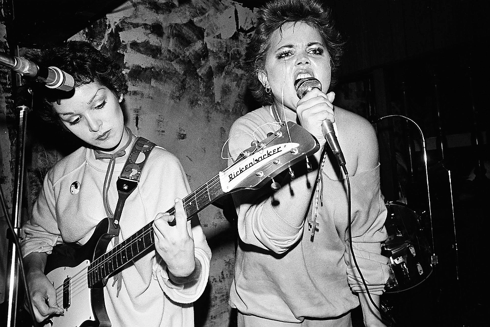 Jane Wiedlin — who had just taken up her instrument — and Belinda Carlisle perform in the early days of the Go-Gos. That's a A-flat seventh chord Wiedlin's concentrating on.