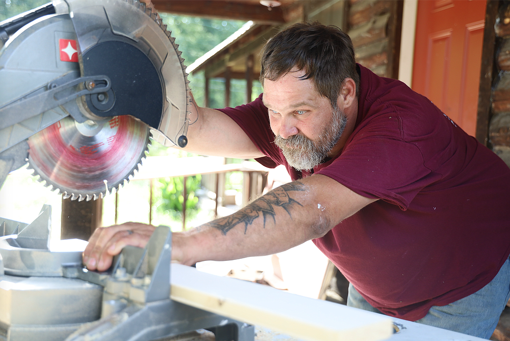 Chet Waters lines up a cut. The former inmate is working to build a new life after years of addiction and jail time. (Special to the Democrat-Gazette/Dwain Hebda)