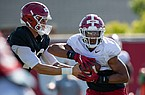 Arkansas running back Rakeem Boyd (5) takes a handoff from quarterback Feleipe Franks during practice Friday, Aug. 21, 2020, in Fayetteville.
