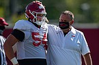 Arkansas football coach Sam Pittman (right) talks with offensive lineman Austin Nix during practice Friday, Aug. 21, 2020, in Fayetteville.