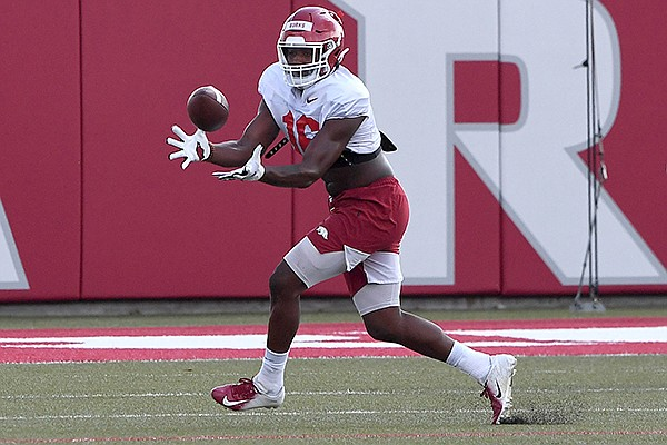 Arkansas receiver Treylon Burks catches a pass during practice Monday, Aug. 24, 2020, in Fayetteville.