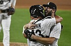 Chicago White Sox starting pitcher Lucas Giolito, right, hugs catcher James McCann and Jose Abreu, back left, after closing out a no-hitter in the team's baseball game against the Pittsburgh Pirates, Tuesday, Aug. 25, 2020, in Chicago. (AP Photo/Matt Marton)