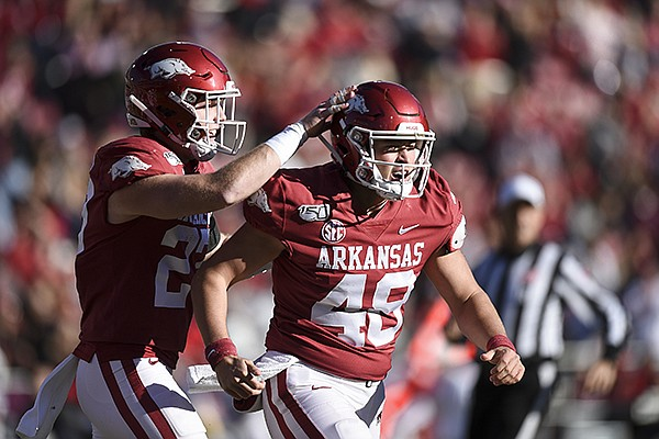 Arkansas long snapper Jordan Silver (48) reacts after recovering a fumble during a game against Mississippi State on Saturday, Nov. 2, 2019, in Fayetteville.