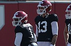 Arkansas quarterbacks Feleipe Franks (13) and KJ Jefferson (1) are shown during practice Tuesday, Aug. 25, 2020, in Fayetteville.
