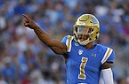 UCLA quarterback Dorian Thompson-Robinson stands on the field during the first half of an NCAA college football game against Oklahoma Saturday, Sept. 14, 2019, in Pasadena, Calif. (AP Photo/Mark J. Terrill)