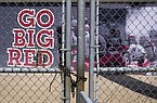 Gates leading into Memorial Stadium are padlocked, in Lincoln, Neb., Wednesday, Aug. 12, 2020. The Big Ten won't play football this fall because of concerns about covid-19, becoming the first of college sports' power conferences to yield to the pandemic. (AP Photo/Nati Harnik)