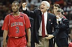 Arizona coach Lute Olson yells instructions to his team during the first half of their Final Four semifinal game against Arkansas at the Charlotte Coliseum on Saturday, April 2, 1994, in Charlotte, N.C. At left is Arizona guard Khalid Reeves (3). (AP Photo/Bob Jordan)