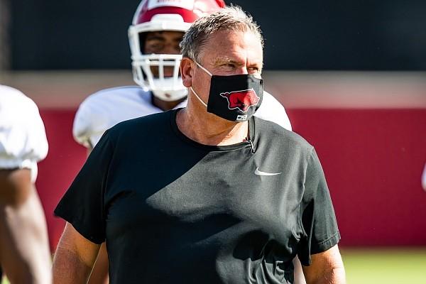 Arkansas football coach Sam Pittman is shown watching the Razorbacks' first scrimmage of the preseason on Aug. 28, 2020.