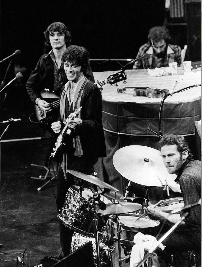 The  Band  (from  top  right,  clockwise):  Richard  Manuel  on  piano,  Levon Helm on drums, lead guitarist Robbie Robertson and bass guitarist Rick Danko, take the stage for their final live performance at Winterland Auditorium in San Francisco on Nov. 27, 1976.(AP file photo)