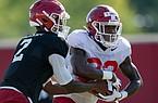 Arkansas running back Trelon Smith takes a handoff from quarterback Malik Hornsby during a preseason practice on Aug. 21, 2020.