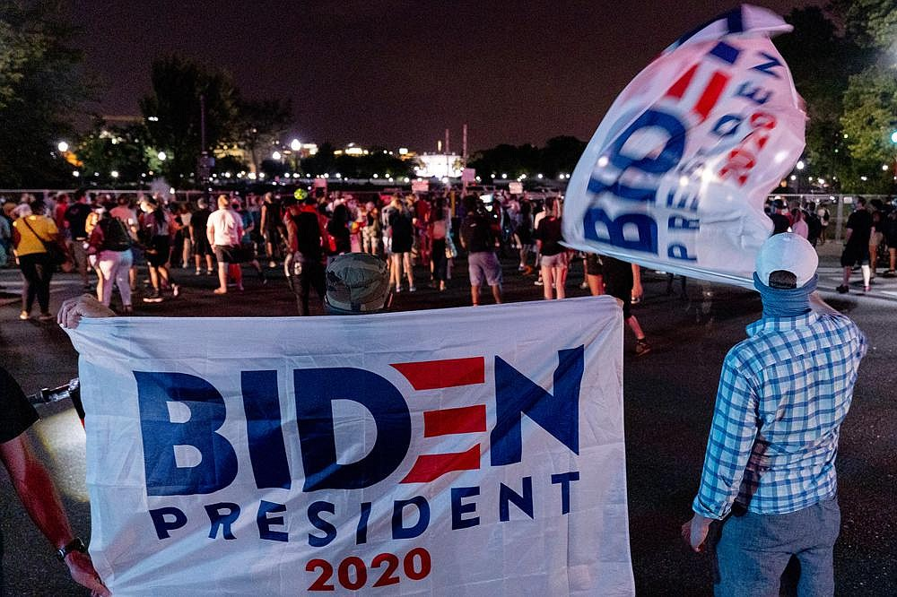 Supporters of Joe Biden gather Thursday near the White House on the fourth day of the Republican National Convention.