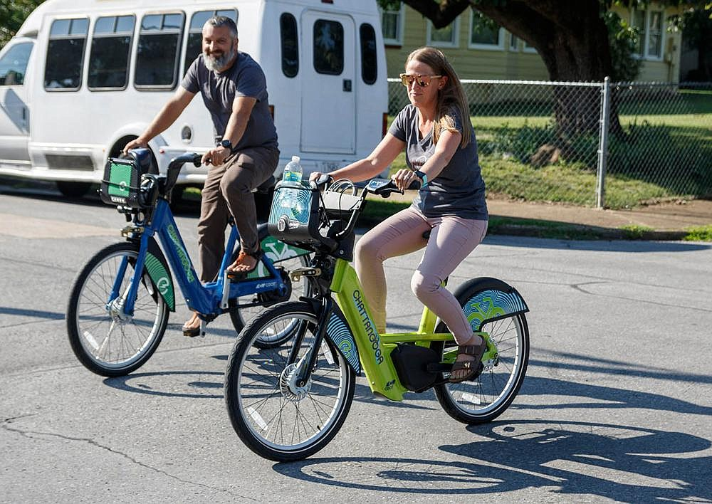 Scott Acord (left) and Holly Acord take a test ride during the launch of a bicycle rental station at Chattanooga's Tatum Park in July 2019; it's wise for riders to familiarize themselves with e-bikes before taking to the roads.