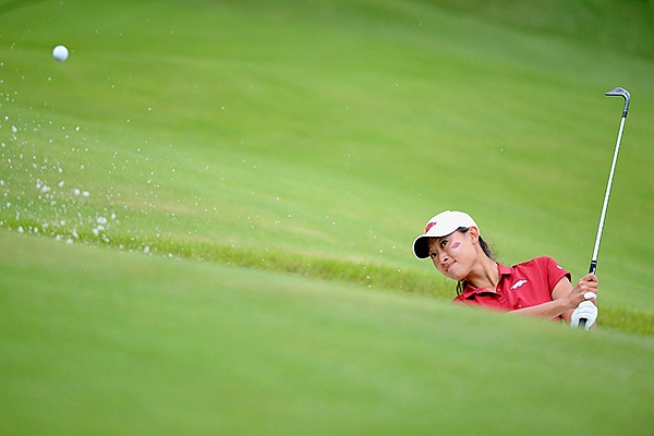 Dylan Kim of Arkansas hits onto the 13th green Tuesday, May 21, 2019, during her match with Siyun Liu of Wake Forest in the Women's NCAA Golf Championship at Blessings Golf Club in Johnson.