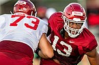 Arkansas defensive end Julius Coates (13) goes against offensive lineman Noah Gatlin (73) during practice Monday, Aug. 24, 2020, in Fayetteville.