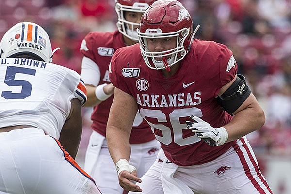 Arkansas offensive lineman Ty Clary (66) prepares to block Auburn defensive tackle Derrick Brown (5) during a game Saturday, Oct. 19, 2019, in Fayetteville.