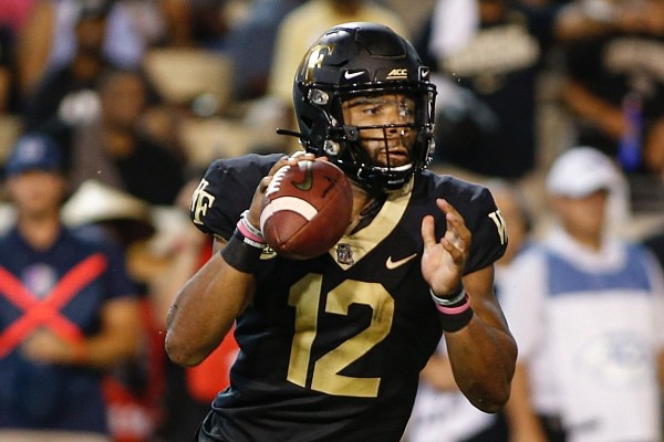 Wake Forest quarterback Jamie Newman looks to pass against Utah State in the first half of an NCAA football game in Winston-Salem, N.C., Friday, Aug. 30, 2019. Wake Forest won 38-35. (AP Photo/Nell Redmond)