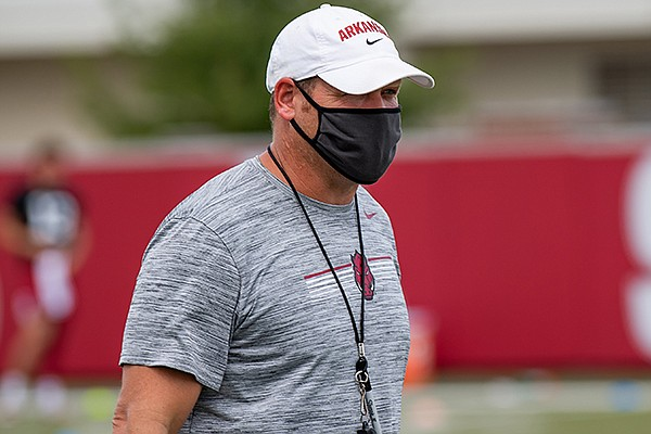 Arkansas defensive coordinator Barry Odom watches a July 2020 workout in Fayetteville.