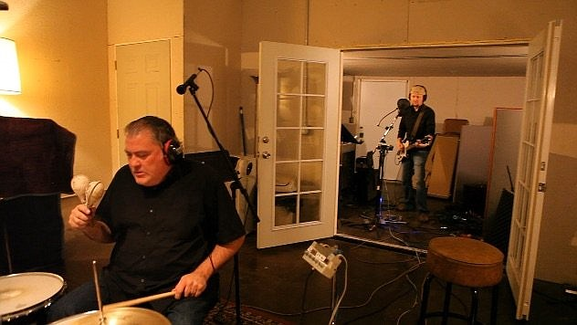Los Lobos founding member David Hidalgo (front) and Greg Spradlin are shown during a 2011 recording session at Manny's Estudio International in East L.A.  (Special to the Democrat-Gazette/Jeremy Seifert)