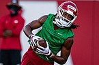 Arkansas receiver Trey Knox is shown running after making a catch in a preseason practice on Aug. 17, 2020.