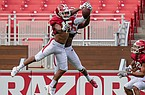 Arkansas defensive back Simeon Blair (15) intercepts a pass intended for receiver Treylon Burks (16) during a scrimmage Friday, Sept. 4, 2020, in Fayetteville.