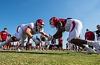 An Arkansas offensive lineman and defensive lineman go head-to-head in a drill during a preseason practice on Aug. 25, 2020.