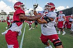 Arkansas freshman Marcus Henderson (right) is shown during practice Monday, Aug. 24, 2020, in Fayetteville.