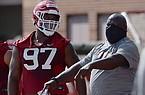 Arkansas defensive lineman Xavier Kelly (97) listens to defensive line coach Derrick LeBlanc during practice Monday, Aug. 17, 2020, in Fayetteville.