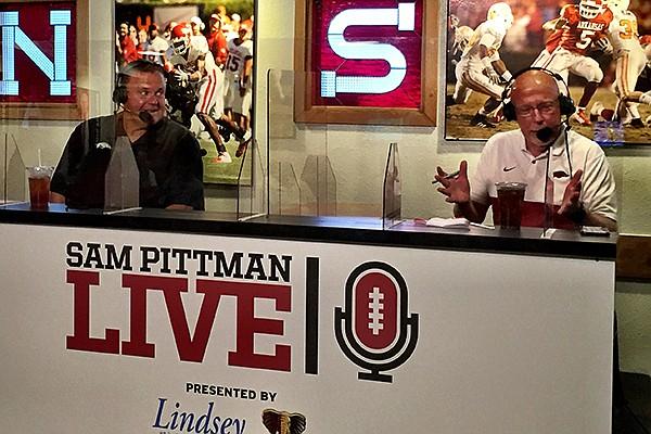 Arkansas coach Sam Pittman (left) and radio announcer Chuck Barrett are shown during Pittman's radio show Wednesday, Sept. 9, 2020, in Fayetteville.