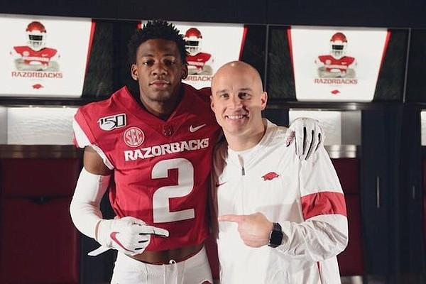 Arkansas receiver commit Jaedon Wilson and Razorbacks receivers coach Justin Stepp.