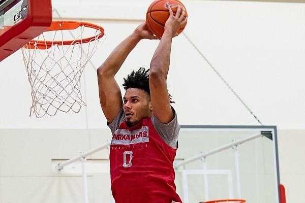 Arkansas forward Justin Smith dunks the ball during a preseason practice in the Basketball Performance Center.