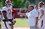 Arkansas coach Sam Pittman directs members of the offensive line Tuesday, Aug. 25, 2020, during practice at the university practice facility in Fayetteville.