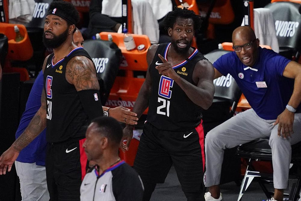 Los Angeles Clippers' Patrick Beverley (21) reacts with teammate Marcus Morris Sr. (31) after being ejected during the second half of an NBA conference semifinal playoff basketball game against the Denver Nuggets Saturday, Sept. 5, 2020, in Lake Buena Vista, Fla. The Nuggets won 110-101.  (AP Photo/Mark J. Terrill)