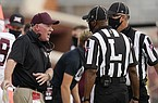 Missouri State head coach Bobby Petrino talks with officials in the first half of an NCAA college football game against Oklahoma Saturday, Sept. 12, 2020, in Norman, Okla. (AP Photo/Sue Ogrocki, Pool)