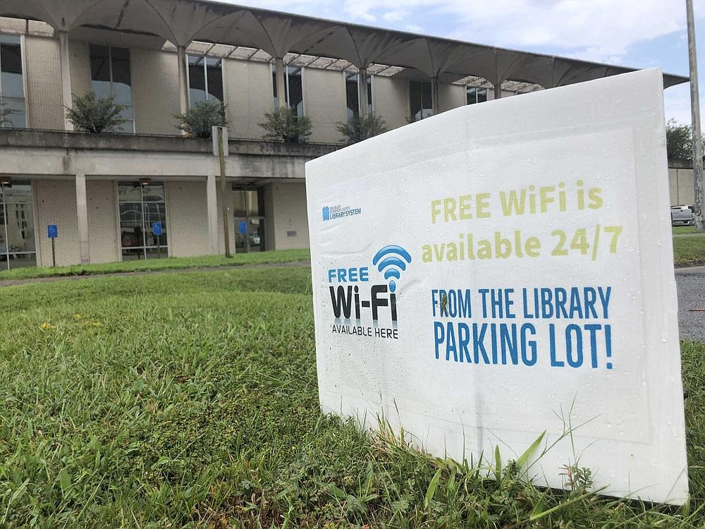 A sign advertises public Wi-Fi at the Pine Bluff Public Library, one of several public internet networks in place around the state to help online students who don't have internet connections at home.