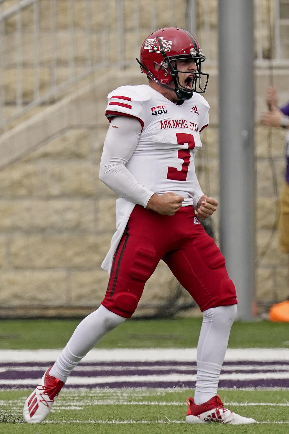 Quarterback Layne Hatcher celebrates after throwing a touchdown pass for Arkansas State during the second half of Saturday's game. (AP/Charlie Riedel)