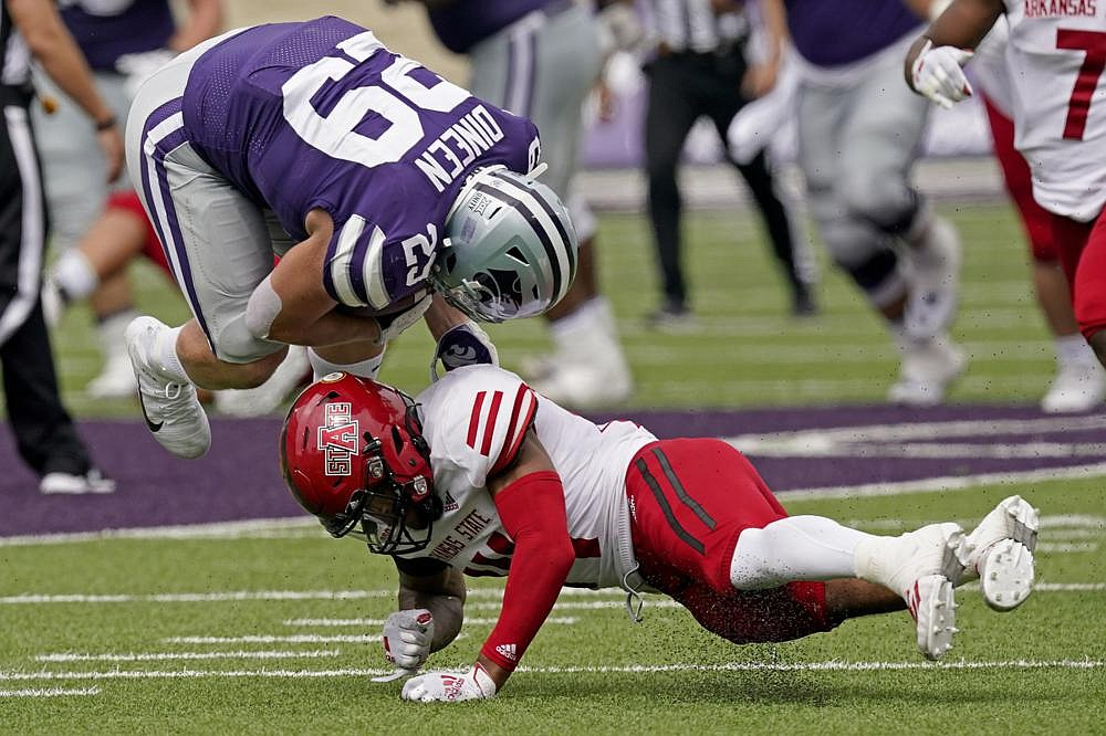 Arkansas State defensive back Antonio Fletcher upends Kansas State fullback Jax Dineen during the second half of Saturday's game in Manhattan, Kan. (AP/Charlie Riedel)