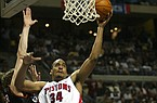 Detroit Pistons' Corliss Williamson, center, drives past Philadelphia 76ers defenders Kyle Korver, left, and Willie Green, background right, during the third quarter Sunday, March 14, 2004, in Auburn Hills, Mich. Williamson led the Pistons with 16 points in their 85-69 win. (AP Photo/Paul Sancya)