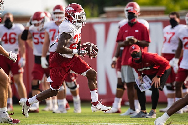 Arkansas running back Trelon Smith runs with the ball during a practice at the Razorbacks' practice facility on September 14, 2020.  Photo courtesy Arkansas communications.