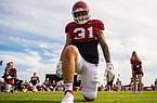 Arkansas linebacker Grant Morgan warms up prior to a preseason practice on Sept. 15, 2020 in Fayetteville.