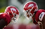 A pair of Arkansas football players ready for a play during a preseason practice on Sept. 14, 2020 in Fayetteville.