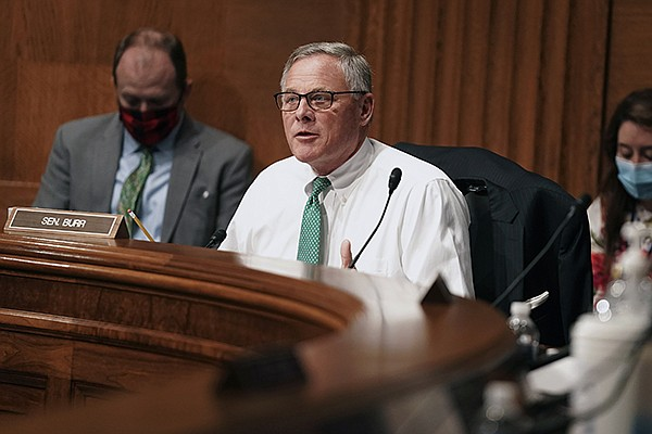 Sen. Richard Burr, R-N.C., attends a Senate Health, Education, Labor and Pensions Committee hearing to discuss vaccines and protecting public health during the coronavirus pandemic on Capitol Hill, Wednesday, Sept. 9, 2020, in Washington. (Greg Nash/Pool via AP)