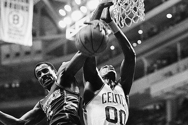 Milwaukee Bucks guard Sidney Moncrief, left, takes the ball away from Boston Celtics Robert Parish during second quarter NBA playoff action at the Boston Garden, May 16, 1984. Boston defeated Milwaukee 119-96 in Game 1 of the series. (AP Photo/Elise Amendola)