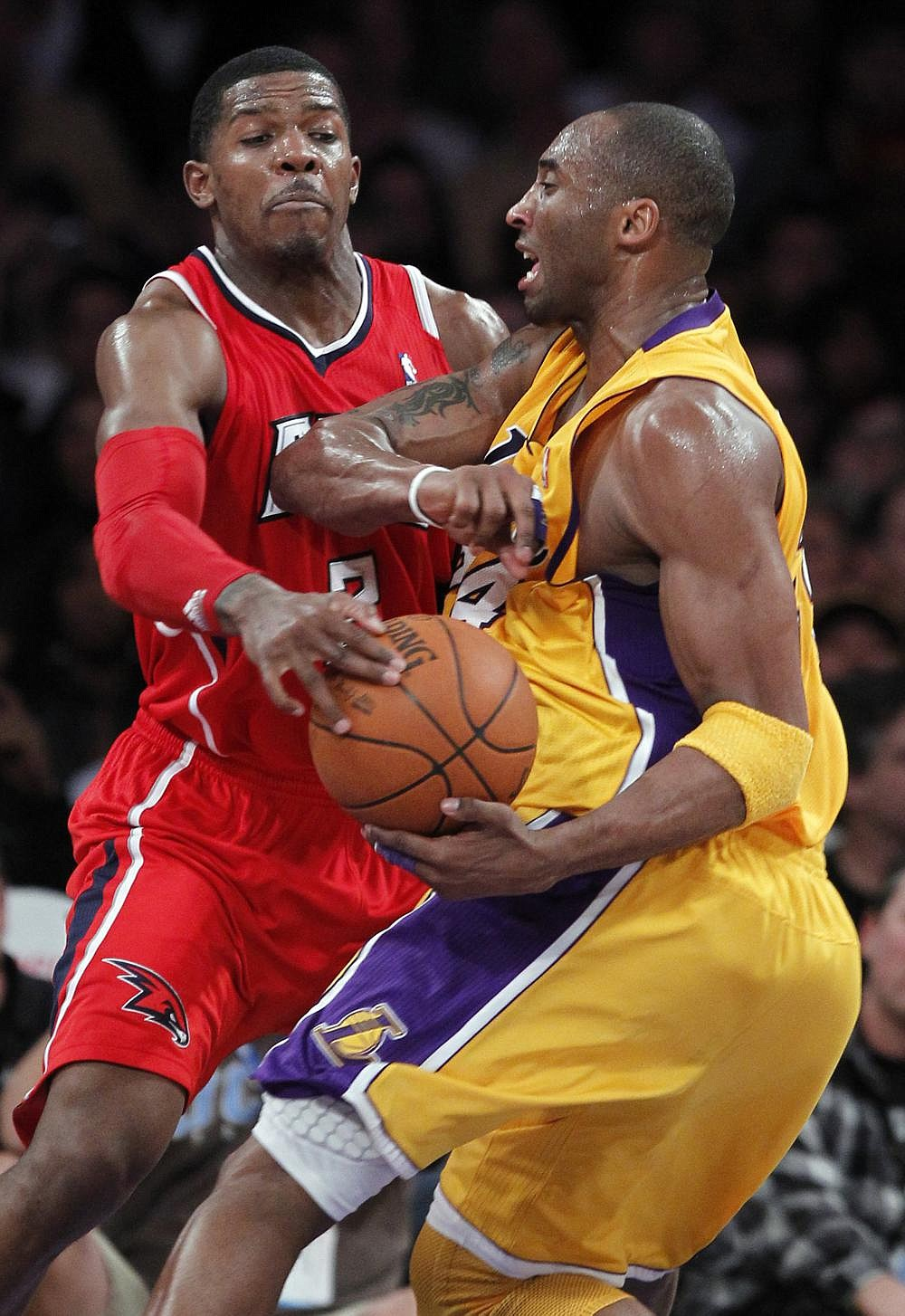 Former Arkansas guard Joe Johnson (left) strips the ball from Kobe Bryant during an NBA game in 2011. Johnson played 17 years in the NBA and was a seven-time All-Star, finishing with 20,405 points in his career. (AP file photo)