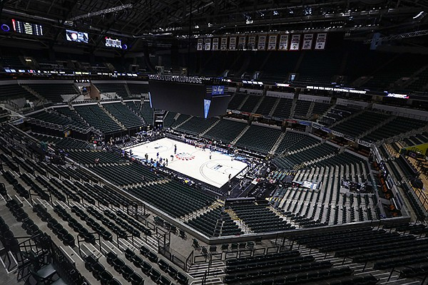 In this March 12, 2020, file photo, the seating area at Bankers Life Fieldhouse is viewed in Indianapolis after the Big Ten Conference announced that remainder of the men's NCAA college basketball games tournament was canceled. Indianapolis city leaders want the college basketball world to know it is open for business. On Friday, Sept. 18, 2020, Indiana Sports Corp, a local, year-round organizing committee, publicly released a 16-page proposal to convert convert about half of the city convention center's exhibition halls and meeting rooms into basketball courts and locker rooms, providing expansive safety measures and daily COVID-19 testing. (AP Photo/Michael Conroy, File)