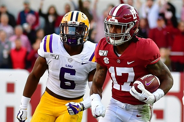 Alabama's Jaylen Waddle (17) returns a punt for a touchdown as LSU's Jacob Phillips (6) gives chase in the first half of an NCAA college football game, Saturday, Nov. 9, 2019, in Tuscaloosa, Ala. (AP Photo/Vasha Hunt)